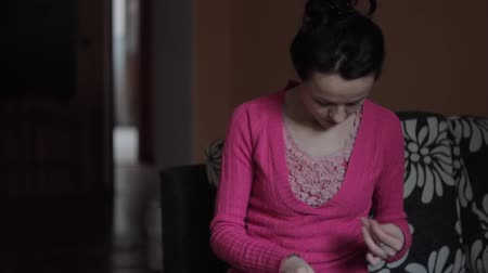 tricky : girl with needle manually sews their clothes