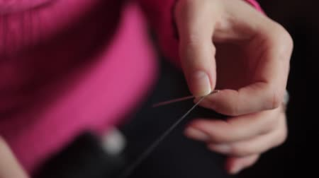 tricky : Threading the eye of a needle Stock Footage