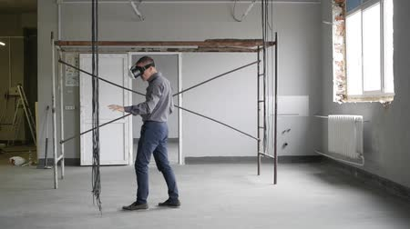 Man uses virtual reality glasses