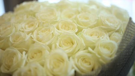 A large bouquet of white roses