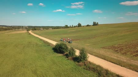 furrow : Drone flies over agricultural machinery Stock Footage