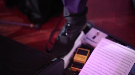 dengeleme : Foot of rock guitarist playing wah wah pedal