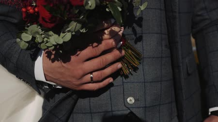 rastr : The groom holds the brides hand with the ring on your finger