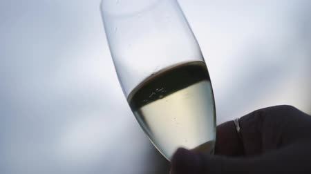 champagne flute : champagne bubbles rising up to top of glass