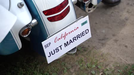 vőlegény : Just married sign number on motorbike Stock mozgókép