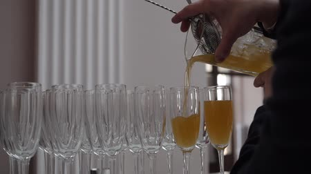 охлажденный : Cocktail pouring from a shaker into glasses Стоковые видеозаписи