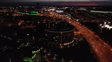 bankomat : The drone flies over the highway through the night city