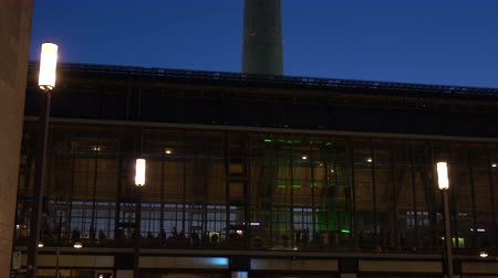 tv tower : ALEXANDERPLATZ RAILWAY STATION AND THE BERLINER FERNSEHTURM, TELEVISION TOWER, MITTE DISTRICT, BERLIN, GERMANY – 13 FEBRUARY 2018: 4K tilt up night time video, Alexanderplatz Railway Station and the Berliner Fernsehturm Television Tower, Berlin Stock Footage