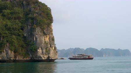 ba : Traditional cruise boat sailing through the limestone islands, Ha Long Bay, Cat Ba National Park, Vietnam