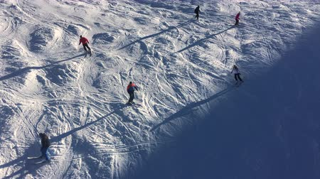 chair lift : 4K aerial video clip of people skiing and chair lift on a sunny winter mountain