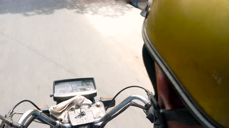 rider : Point of view 4K video from the rider of a motorbike, motorcycle or scooter on a street or rural road, Vietnam Stock Footage