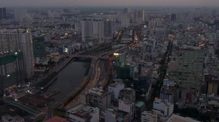 Aerial view of the Ben Nghe River, city skyline and traffic on the streets of Ho Chi Minh City, Vietnam Dostupné videozáznamy
