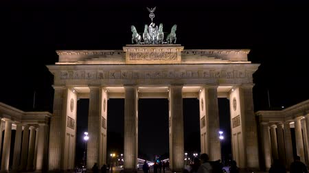 focus pull : THE BRANDENBURG GATE, PARISER PLATZ, BERLIN, GERMANY – 15 FEBRUARY 2018, Tilt down 4K Video clip of people at night by The Brandenburg Gate, Pariser Platz, Berlin, Germany