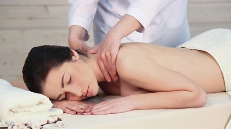 revitalizing : girl doing massage in the Spa