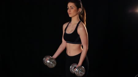 łazienka : girl deals with dumbbells