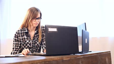 desperate student : business girl sits at a computer in the Office paper folders