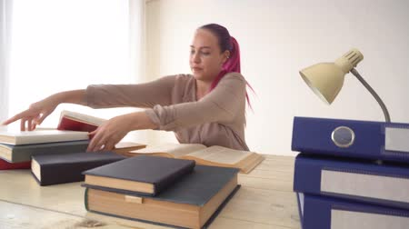 documents : business girl sits in the Office for books folders of paper Secretary
