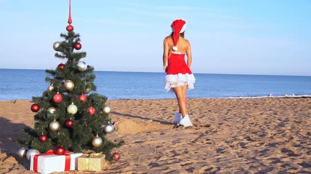 santaclaus : girl on beach resort in Christmas clothes for the new year 1 Stock Footage