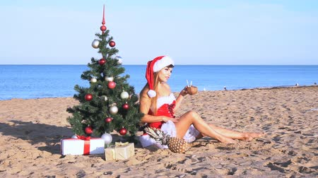 santaclaus : girl on beach resort in Christmas clothes for the new year Stock Footage