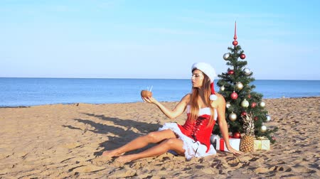 santaclaus : girl on beach resort in Christmas clothes for the new year in the tropics 1 Stock Footage