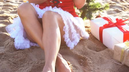 santaclaus : girl on beach resort in Christmas clothes for the new year in the tropics Stock Footage