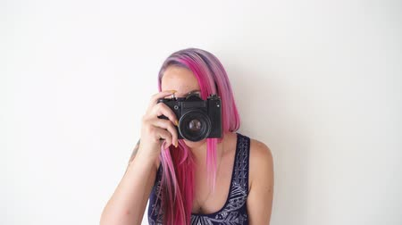 nude : girl with pink hair makes photos on the vintage camera