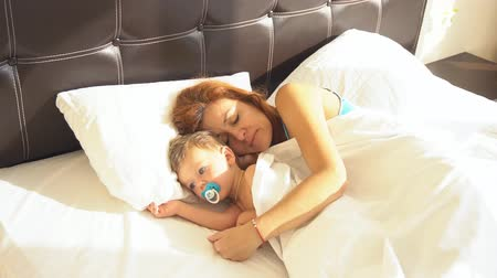 cradle : mom with son baby woke up in the morning on the bed