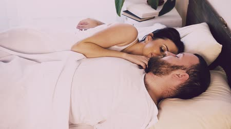 casal heterossexual : husband and wife wake up in the morning in the bedroom