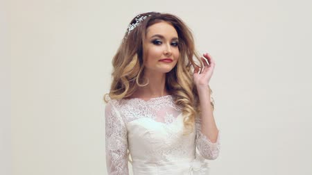 korona : blonde bride in a wedding dress on a white background
