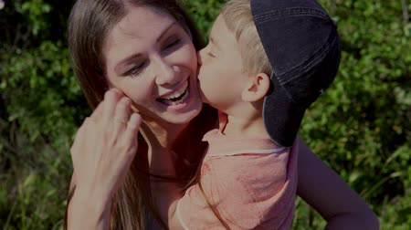 мама : mom and young boy hugging Kiss laugh in box