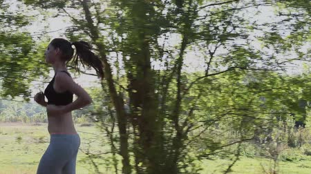 tank top : brunette girl is running through the Woods Stock Footage
