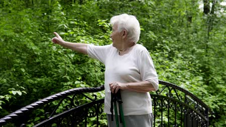 loved : Grandma walks in the park with sticks for Nordic walking in retirement