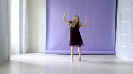 Young girl listening music and dancing