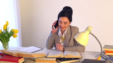 Confident woman in spectacles skilled office manager with paper documents Stok Video