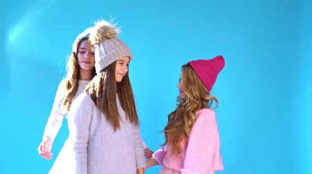 Schoolgirls three beautiful girls in a winter snow cap