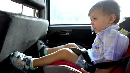 mamilo : Boy with nipple rides car seat Stock Footage