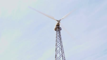kinetik : the blades of a working wind farm