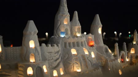 zamek : Castle with candles made from sand on the beach.