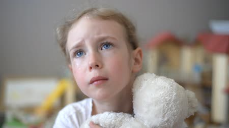 наказание : Crying little girl with bear in the childrens room.