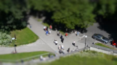 outside view : Tourists in the city. Tilt-shift. Stock Footage