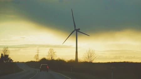 fenntartható : Wind turbine in the field on the sunset. Eco-energy concept.
