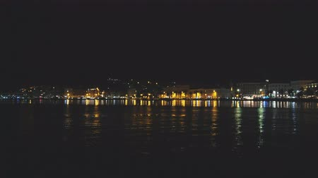 port n : Beautiful view on the old town and Marjan park in Split, Croatia at night.