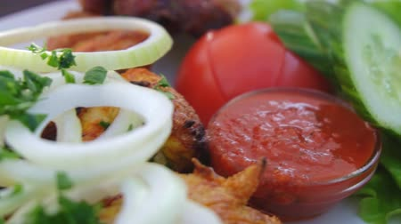 паб : Delicious grilled shashlik with adjika and vegetables. Стоковые видеозаписи