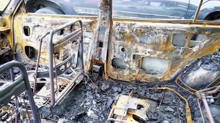 paslanmış : Burned out car after a car accident. Inside view. Stok Video
