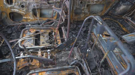 sabotage : Burned out car after a car accident. Inside view. Stock Footage