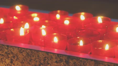 redemption : Burning candles on altar in church.