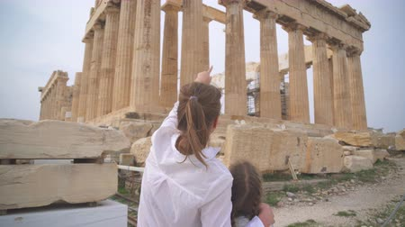 education kids : Family near ancient Parthenon in the Athenian Acropolis.