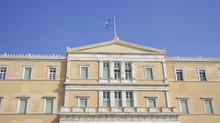 greek flag : Building of the Hellenic Parliament in Athens, Greece.