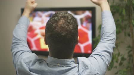 watch tv : Goal! Man watching football at home. Stock Footage