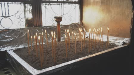 redemption : Many candles glowing on the table in the church.
